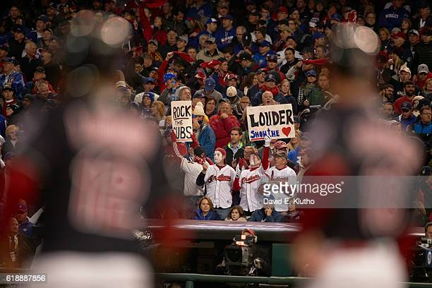 World Series Cleveland Indians fans in stands holding signs that read ROCK THE CUBS and SHOW THE LOVE during game vs Chicago Cubs at Progressive...