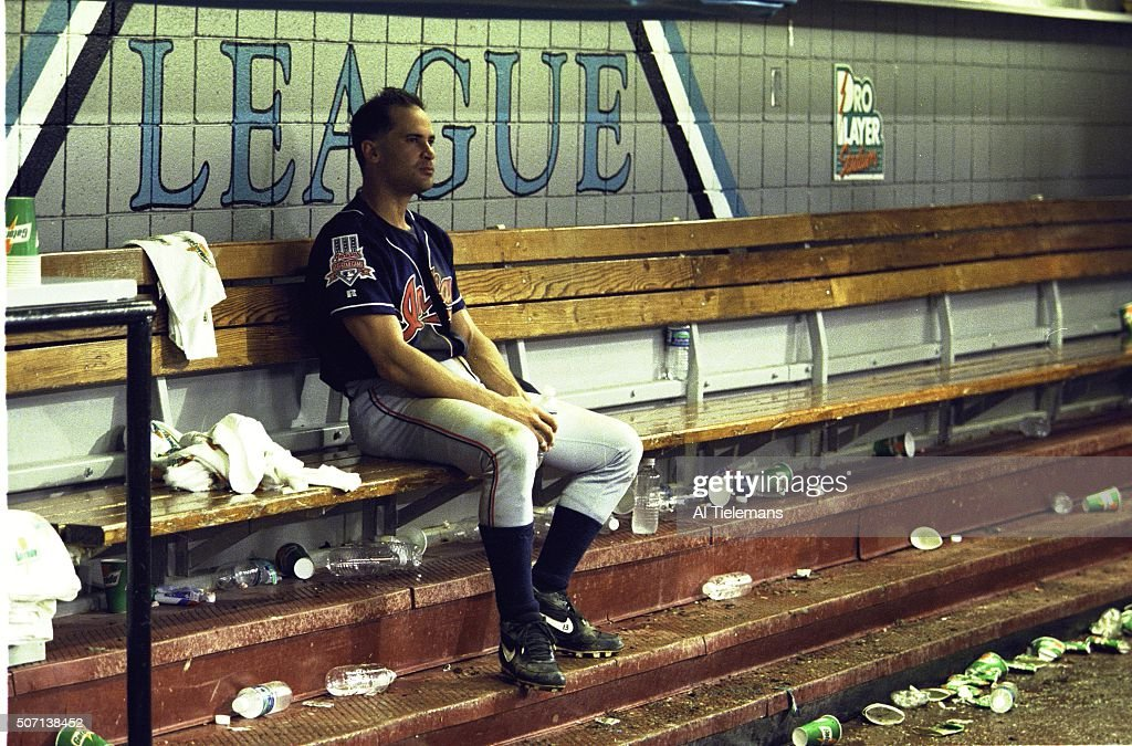 Cleveland Indians Omar Vizquel (13) upset, sitting in dugout after losing Game 7 and championship series vs Florida Marlins and Pro Player Stadium. Al Tielemans X53795 )