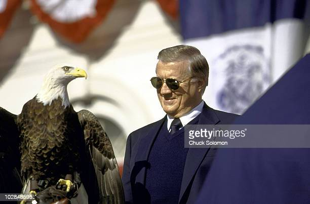 World Series Closeup of New York Yankees owner George Steinbrenner victorious with Challenger the American Bald Eagle during Victory Parade on...