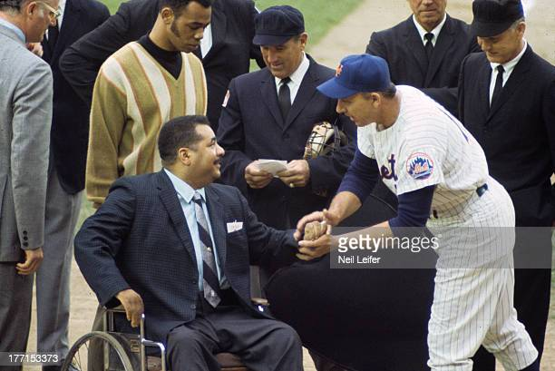 World Series Former Brooklyn Dodgers player Roy Campanella in wheelchair during ceremony with New York Mets manager Gil Hodges before Game 3 vs...