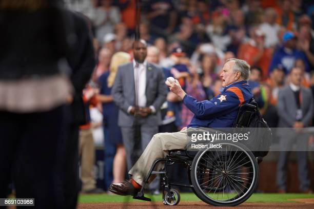 World Series Former United States President George HW Bush in wheelchair on field during ceremonial first pitch before Houston Astros vs Los Angeles...