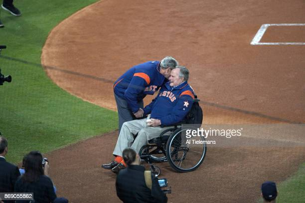 World Series Former United States Presidents George HW Bush and George W Bush before ceremonial first pitch on field before game vs Los Angeles...