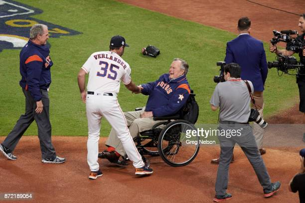 World Series Former USA President George HW Bush shaking hands with Houston Astros Justin Verlander before ceremonial first pitch on field before vs...