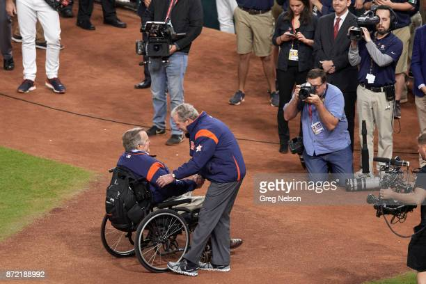 World Series Former USA President George W Bush shaking hands with his father and former USA President George HW Bush before throwing out ceremonial...