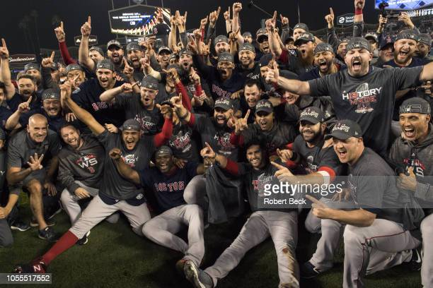 World Series Group portrait of Boston Red Sox players victorious posing for team photo on field after winning Game 5 and championship series vs Los...