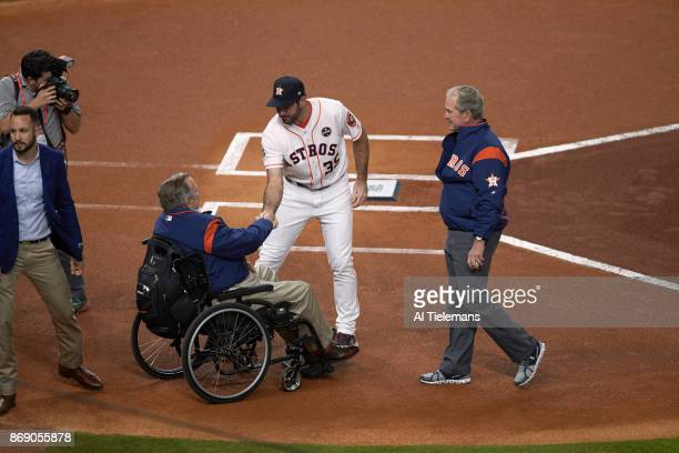 World Series Houston Astros Justin Verlander shaking hands with former President George HW Bush as George W Bush looks on before ceremonial first...