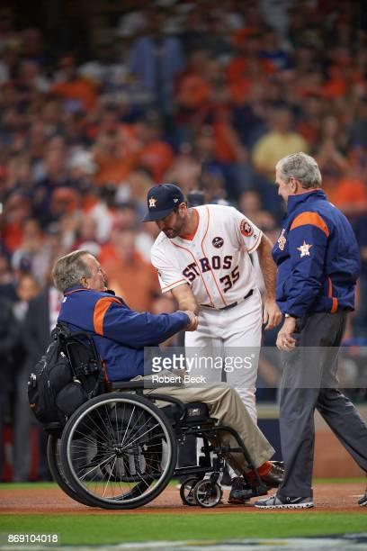 World Series Houston Astros Justin Verlander shaking hands with former United States President George HW Bush in wheelchair on field as George W Bush...