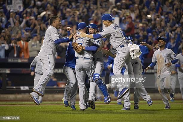 World Series Kansas City Royals Wade Davis victorious with Drew Butera Salvador Perez and Jeremy Guthrie after winning game and series at Citi Field...