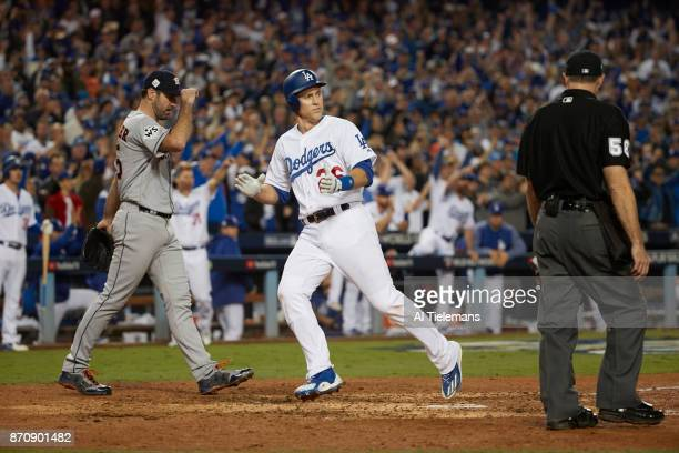 World Series: Los Angeles Dodgers Chase Utley victorious after scoring run vs Houston Astros Josh Reddick at Dodger Stadium. Game 6. Los Angeles, CA...