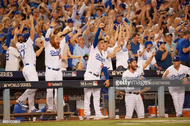 World Series Los Angeles Dodgers Justin Turner Cody Bellinger and Clayton Kershaw victorious in dugout during game vs Houston Astros at Dodger...
