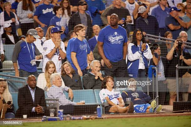 World Series Los Angeles Dodgers part owner Magic Johnson in stands with wife Cookie and former player Sandy Koufax during game vs Boston Red Sox at...