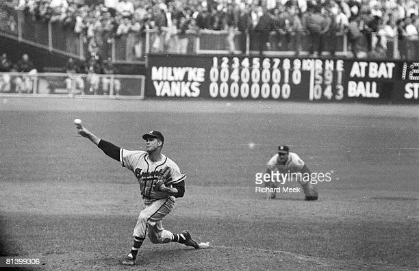 Baseball World Series Milwaukee Braves Lew Burdette in action pitching vs New York Yankees View of scoreboard displaying shutout innings at Yankee...