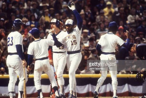 World Series Milwaukee Brewers Cecil Cooper victorious after hitting home run with teammates at home plate during game vs St Louis Cardinals at...