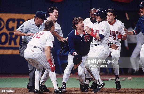 World Series Minnesota Twins Dan Gladden victorious at home plate with teammate Jack Morris and team after scoring 10th inning game winning run to...