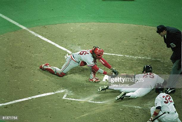 Baseball World Series Minnesota Twins Randy Bush in action scoring run vs St Louis Cardinals Tony Pena Game 2 Minneapolis MN