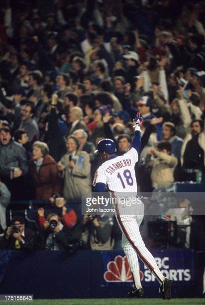 World Series New York Mets Darryl Strawberry victorious after hitting home run during 8th inning vs Boston Red Sox at Shea Stadium Game 7 Flushing NY...