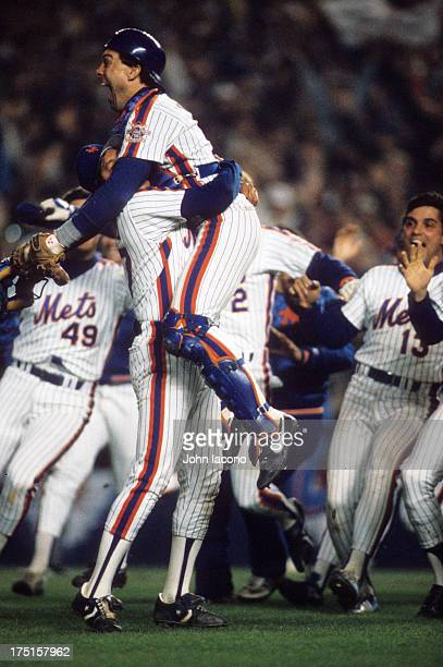 World Series New York Mets Gary Carter and Jesse Orosco victorious after winning Game 7 and championship series vs Boston Red Sox at Shea Stadium...