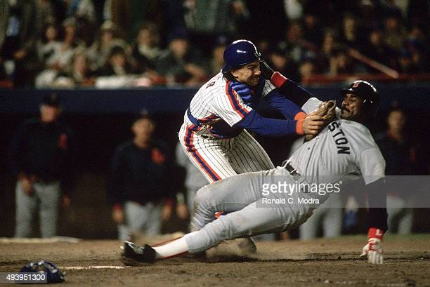 World Series New York Mets Gary Carter in action tagging out Boston Red Sox Jim Rice at home plate at Shea Stadium Game 6 Flushing NY CREDIT Ronald C...