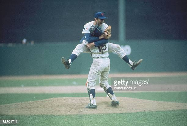 Baseball World Series New York Mets Jerry Koosman victorious hugging Jerry Grote after winning game vs Baltimore Orioles Flushing NY