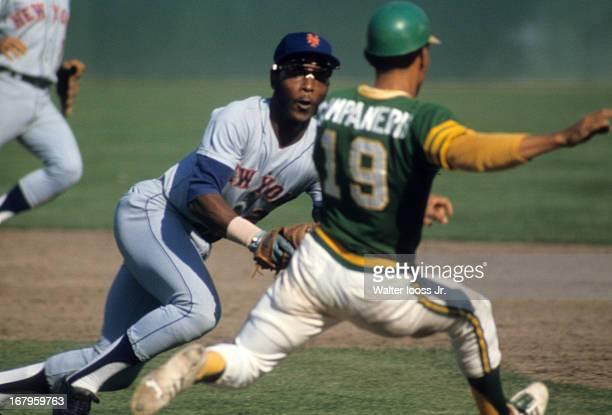 World Series New York Mets John Milner in action vs Oakland Athletics Bert Campaneries at OaklandAlameda County Coliseum Game 1 Cover Oakland CA...