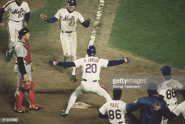 Baseball World Series New York Mets Ray Knight in action scoring game winning run in 10th inning with victorious team during game vs Boston Red Sox...