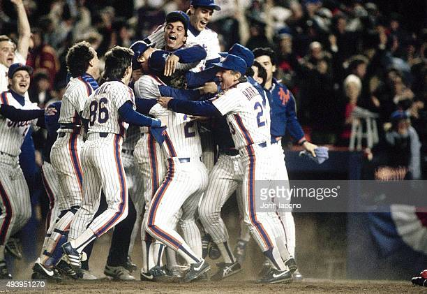 World Series New York Mets Ray Knight victorious with teammates after scoring game winning run vs Boston Red Sox at Shea Stadium Game 6 Flushing NY...