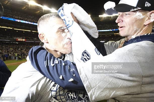 World Series New York Yankees AJ Burnett victorious wiping off cream pie on manager Joe Girardi after winning Game 6 and series vs Philadelphia...