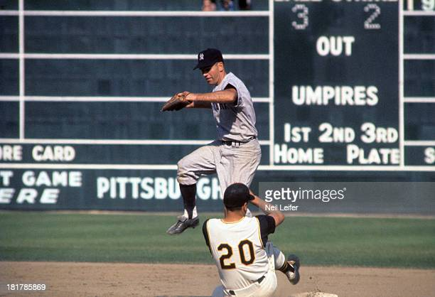 World Series New York Yankees Bobby Richardson in action making double play attempt vs Pittsburgh Pirates Gino Cimoli at Forbes Field Pittsburgh PA...