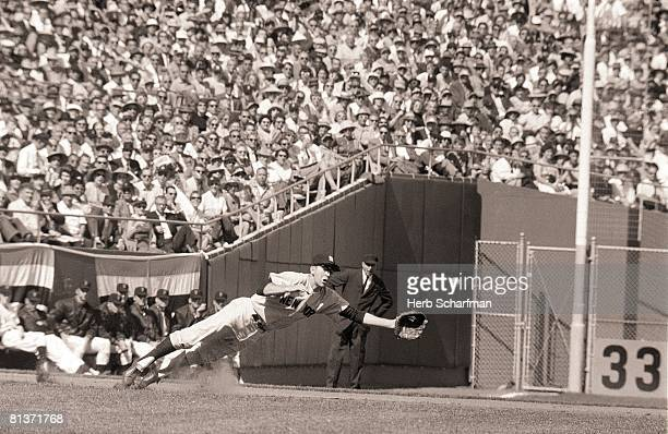 Baseball World Series New York Yankees Clete Boyer in action diving and fielding vs San Francisco Giants Game 1 San Francisco CA 10/4/1962