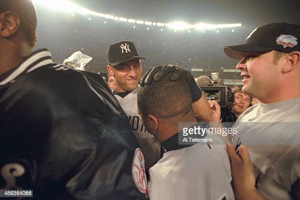 World Series New York Yankees Derek Jeter in action sliding into third base with triple vs New York Mets at Shea Stadium Game 4 Flushing NY CREDIT Al...