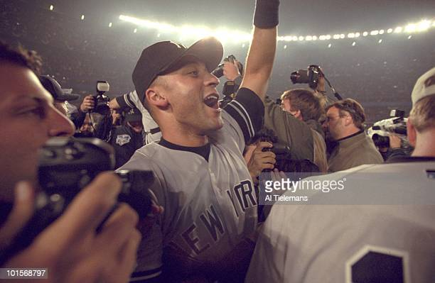 World Series New York Yankees Derek Jeter victorious after winning Game 5 vs New York Mets Flushing NY CREDIT Al Tielemans