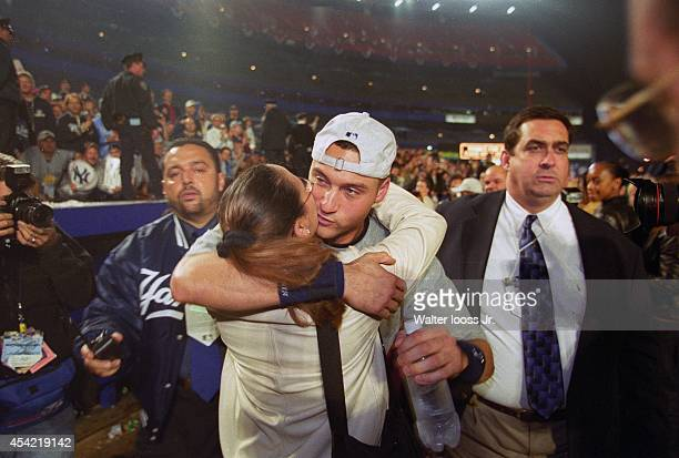 World Series New York Yankees Derek Jeter victorious hugging his sister Sharlee after winning Game 5 and championship series vs New York Mets at Shea...