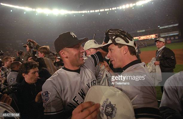 World Series New York Yankees Derek Jeter victorious hugging Tino Martinez after winning Game 5 and championship series vs New York Mets at Shea...