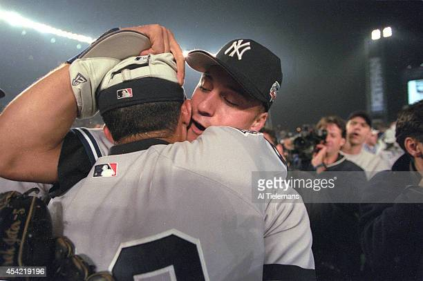 World Series New York Yankees Derek Jeter victorious hugging Mariano Rivera after winning Game 5 and championship series vs New York Mets at Shea...