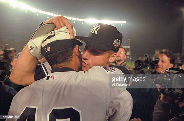World Series New York Yankees Derek Jeter victorious with Mariano Rivera after winning game and series vs New York Mets at Shea Stadium Game 5...