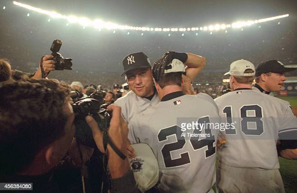 World Series New York Yankees Derek Jeter victorious with Tino Martinez after winning game and series vs New York Mets at Shea Stadium Game 5...