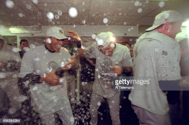 World Series New York Yankees Derek Jeter victorious with Mariano Rivera with champagne shower in locker room after with series vs New York Mets at...