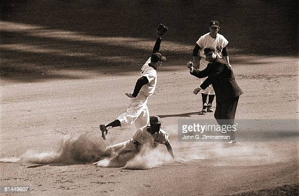 Baseball World Series New York Yankees Gil McDougald in action making tag out vs Brooklyn Dodgers Jackie Robinson Bronx NY 10/6/1956