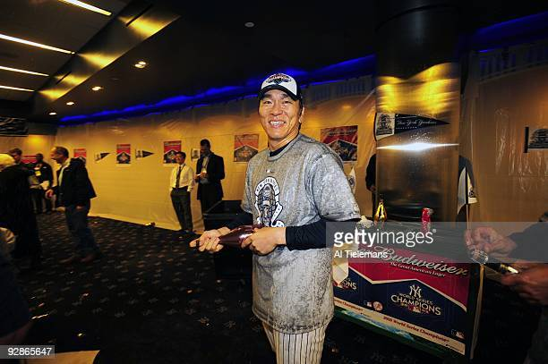 World Series New York Yankees Hideki Matsui victorious spraying champagne in locker room after winning game vs Philadelphia Phillies Game 6 Bronx NY...
