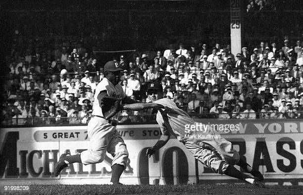 World Series New York Yankees Jerry Coleman in action attempting to pickoff Brooklyn Dodgers Jackie Robinson Game 5 Brooklyn NY 10/2/1955 CREDIT Mark...