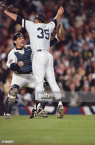 Baseball World Series New York Yankees Joe Girardi victorious with John Wetteland after making final out and winning Game 6 and series vs Atlanta...