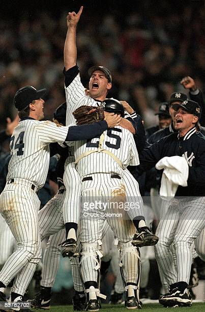 World Series New York Yankees John Wetteland victorious on field with teammates during celebration after winning Game 6 vs Atlanta Braves Cover Bronx...