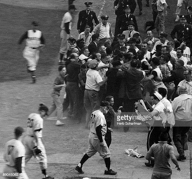 World Series New York Yankees manager Casey Stengel walking off the field after Pittsburgh Pirates Bill Mazeroski hit series winning home run Game 7...