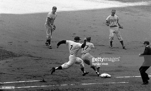 World Series New York Yankees Mickey Mantle in action base running vs Brooklyn Dodgers Carl Erskine Game 4 Bronx NY 10/7/1956 CREDIT Richard Meek