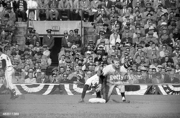 World Series New York Yankees Mickey Mantle in action slide upending Milwaukee Braves Red Schoendienst during Game 3 at County Stadium Milwaukee WI...