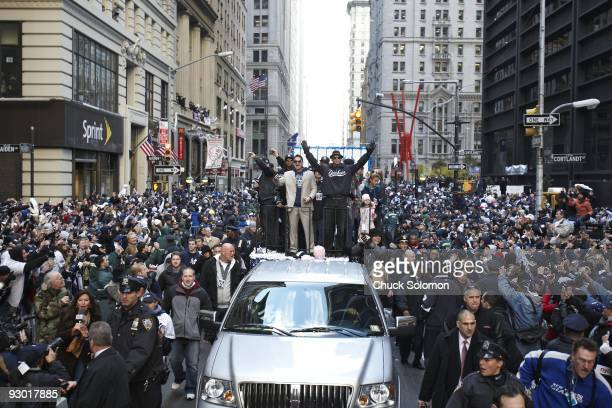 World Series New York Yankees players Alex Rodriguez and Francisco Cervelli with celebrity rapper JayZ on float during tickertape during Victory...