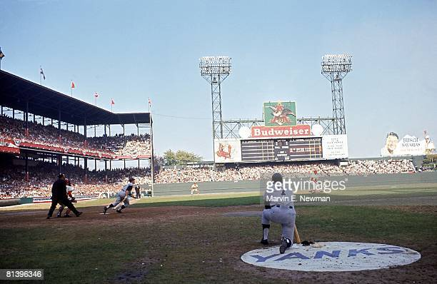 Baseball World Series New York Yankees Roger Maris in action vs St Louis Cardinals Mickey Mantle on deck at Sportsman's Park stadium St Louis MO...
