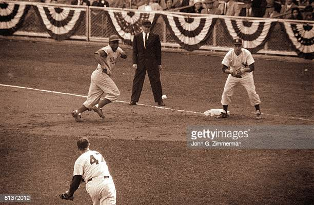 Baseball World Series New York Yankees Tom Sturdivant in action making throw to Joe Collins at first base during pick off attempt vs Brooklyn Dodgers...