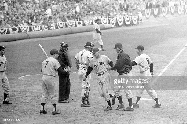 World Series New York Yankees Tony Kubek victorious with Mickey Mantle and teammates at home plate after hitting home run during Game 7 vs Milwaukee...