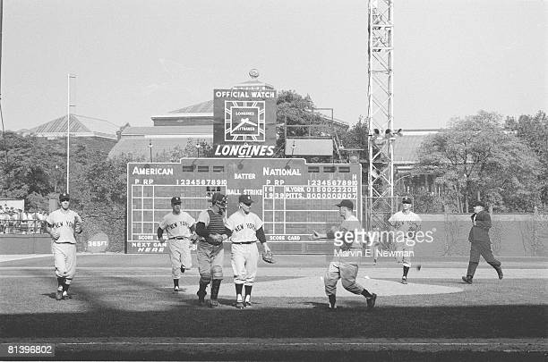 Baseball World Series New York Yankees Whitey Ford victorious with team after winning game vs Pittsburgh Pirates View of scoreboard at Forbes Field...